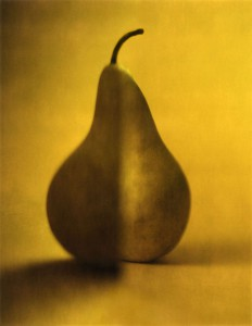 A single Pear is reflected and split in two as a metaphor for the split in the human psyche. Analog manipulation shot on Polaroid film.