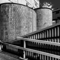 Old storage tanks in black and white.